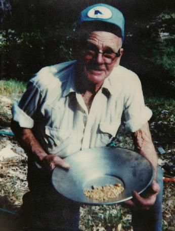 July 26, 1989, Bill Penland, 79 years old at Rich Bar, CA with a Gold Pan and 32 Ounces of Rich Bar Gold in it.