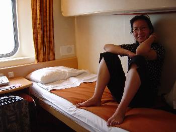 July 1, 2005, Lei on the bed in our sleeper berth on the ferry from Ancona, Italy to Patras, Greece